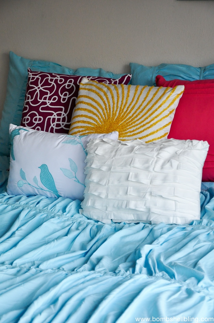 using colorful throw pillows for pops of color. Black Bedroom Furniture Sets. Home Design Ideas